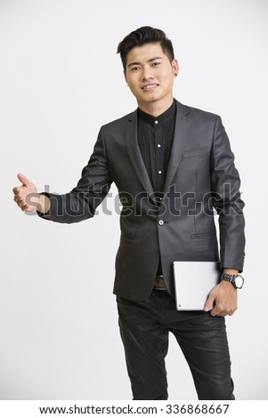Gesturing Young businessman with digital tablet on white. - stock photo