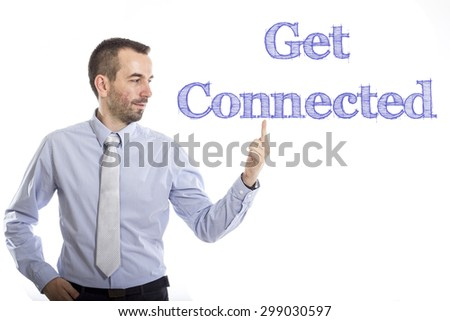 Get connected Young businessman with small beard touching text - stock photo