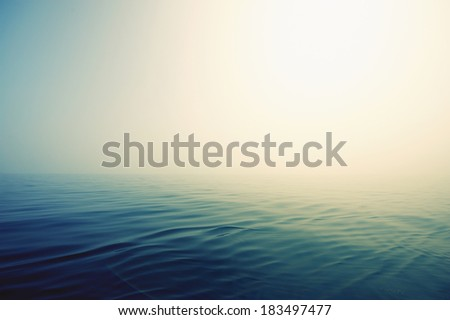Get lost in a peaceful and misty ocean - stock photo