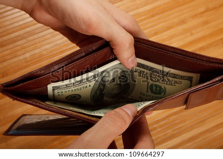 Get money from her purse - stock photo