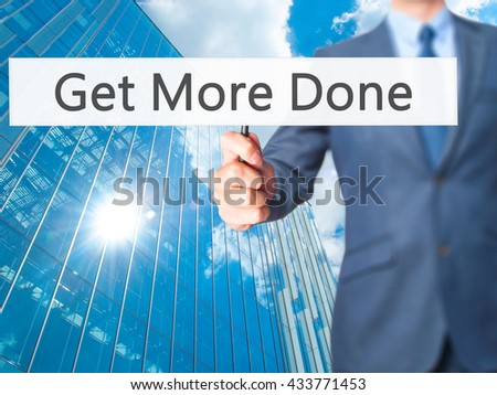 Get More Done - Businessman hand holding sign. Business, technology, internet concept. Stock Photo - stock photo