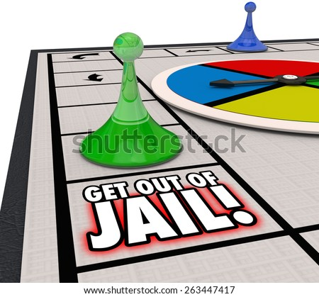 Get Out of Jail words on a board game and player piece moving to illustrate escaping from prisoner after arrest and court - stock photo