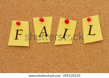 Getting a bad grade, Four yellow notes on a cork board with the word Fail - stock photo