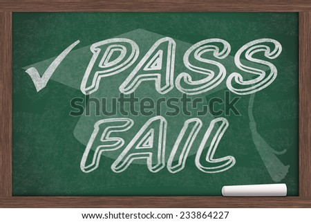 Getting a good grade, Pass and Fail written on a chalkboard with chalk and a grad cap - stock photo