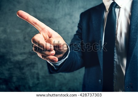 Getting fired from job, office manager showing way out with finger pointing to exit door. - stock photo