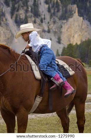 Getting Off the Horse - stock photo