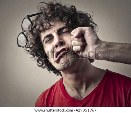 Getting punched in the face - stock photo