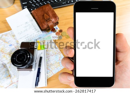 getting ready with smart phone for travel, money, map and photo camera on wooden table with copy space - stock photo