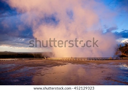 Geyser at sunset. Excelsior Geyser in Midway Geyser Basin of Yellowstone National Park, Jackson Hole, Wyoning, USA.  - stock photo