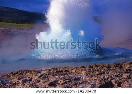 Geyser eruption in Geysir site, Iceland - stock photo