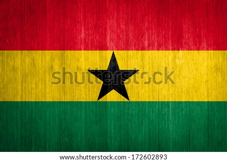 Ghana Flag on wood background - stock photo