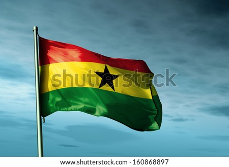 Ghana flag waving in the evening - stock photo