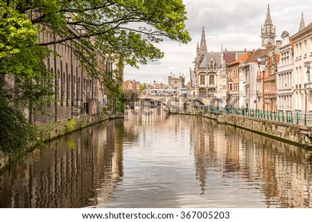 Ghent Old Town Architecture Cityscape and Canal Reflection. View of picturesque houses along channel in Ghent. Ghent is a city and a municipality located in the Flemish region of Belgium. - stock photo