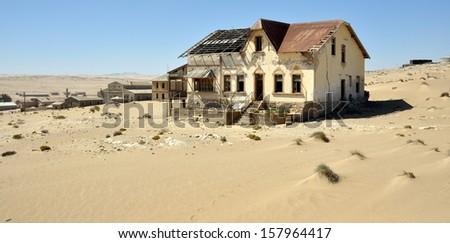 Ghost diamond mining town Kolmanskop near Luederitz, Namibia, Africa - stock photo