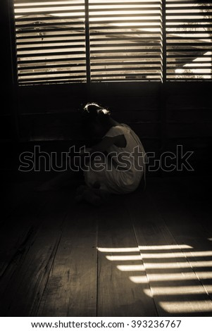 Ghost girl in haunted house,Mysterious girl in white dress sitting in abandon house  - stock photo