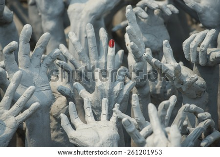 Ghost  hands from hell, Conceptual sculpture decorations in Rongkhun Temple Chiangrai, Thailand. - stock photo
