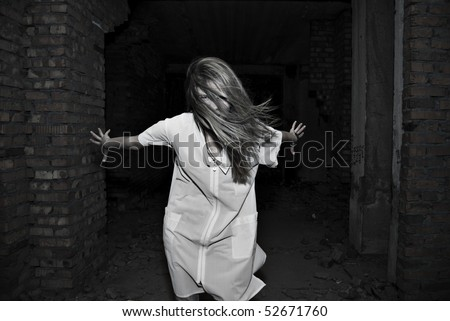 Ghost of girl in dark corridor - stock photo