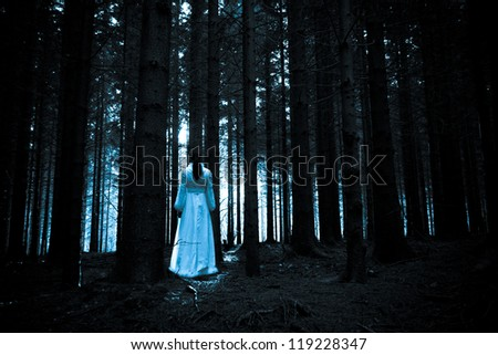Ghost of the lady in a deep dark forest - stock photo