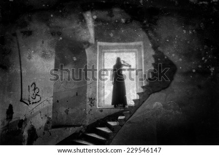 Ghost standing in a window - stock photo
