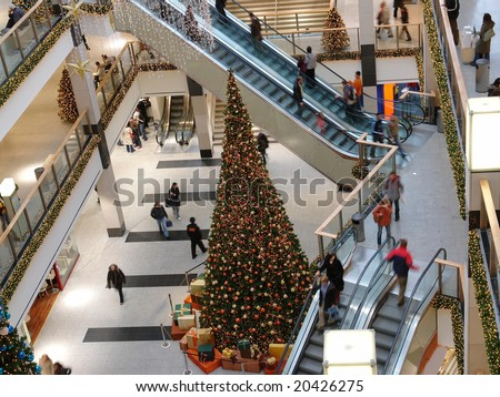 Giant christmas tree in multilevel shopping mall - stock photo