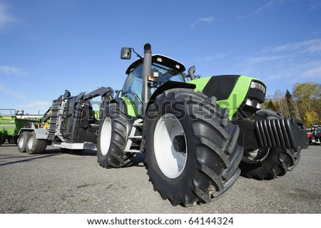 giant farming tractor with special plow, all trademarks removed - stock photo