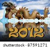 Giant golden Chinese dragon for year 1212 - stock photo