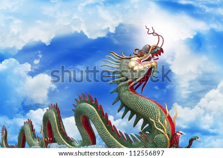 Giant golden Chinese dragon with blue sky background - stock photo