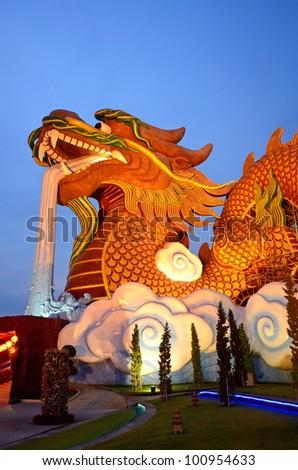 Giant Golden dragon statue on twilight - stock photo