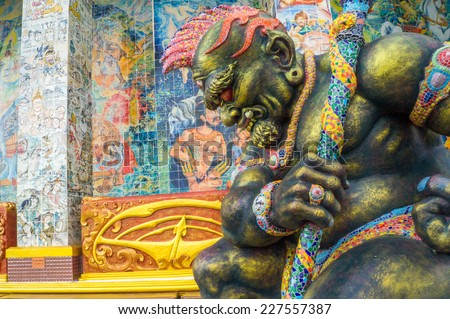 Giant guardian of sanctuary in Ban Rai temple, Korat, Thailand - stock photo