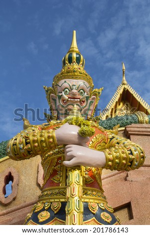 Giant guardian statue in front of thai temple - stock photo