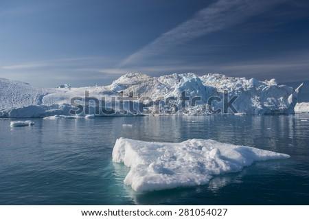 Giant Icebergs of Disko Bay near Illulisat, Greenland, a popular cruise destination - stock photo