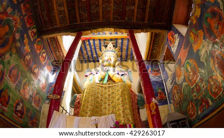 Giant Maitreya Buddha statue in Namgyal Tsemo Gompa with walls richly decorated with wall paintings in Leh (Ladakh, Jammu and Kashmir, northern India) - stock photo