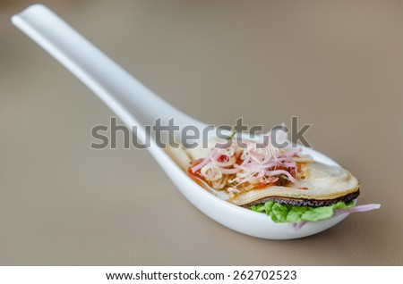 giant mussel with spicy chili sauce on spoon - stock photo
