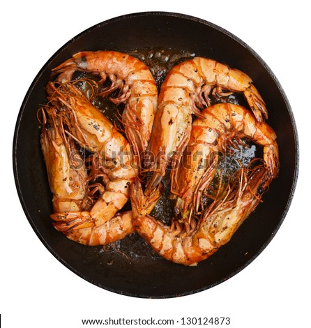 Giant prawns being fried on pan, isolated on white - stock photo