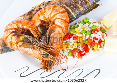 Giant prawns with sea bass fish. - stock photo
