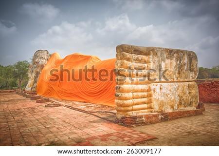Giant Reclining Buddha in Wat Lokayasutharam. Ayutthaya historical park.  - stock photo