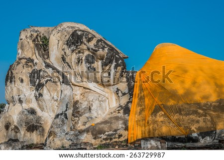 giant reclining buddha statue at Wat Lokayasutharam Ayutthaya Bangkok Thailand - stock photo