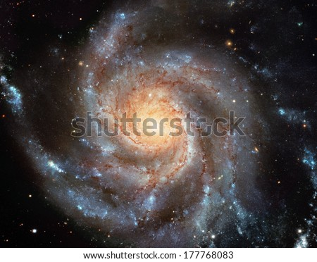 Giant spiral disk of stars, dust and gas is 170,000 light-years across. The spiral galaxy M101 is estimated to contain at least one trillion stars. Cleaned and retouched image, original by ESA-Hubble  - stock photo