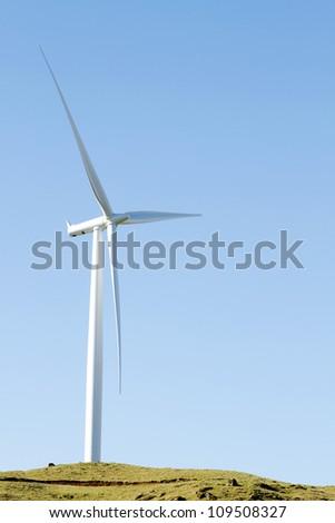 Giant wind turbine on hill - stock photo