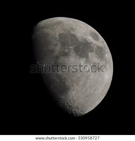 Gibbous moon over dark black sky (picture taken with my own telescope, NO NASA images used) - stock photo
