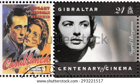GIBRALTAR - CIRCA 1995. A postage stamp printed by GIBRALTAR shows Swedish actress Ingrid Bergman and American actor Humphrey Bogart starring in the film Casablanca, circa 1995. - stock photo