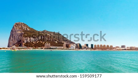 Gibraltar. Gibraltar is a British territory located to south of Iberian Peninsula at entrance to  Mediterranean Sea. The land is one of the most southerly points in Europe. - stock photo