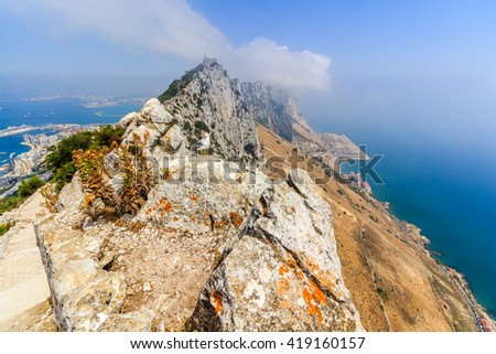 Gibraltar Rock view from above, on the left Gibraltar town and bay, Mediterranean Sea on the right. - stock photo