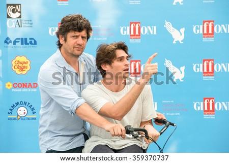 GIFFONI VALLE PIANA (SA) - JULY 18: Actors Fabio De Luigi and Angelo Duro poses at photocall during the 45th Giffoni Film Festival at Cittadella del Cinema, July 18, 2015 in Salerno, Italy. - stock photo