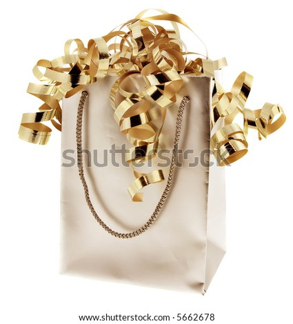 Gift bag with gold ribbons against a white background. - stock photo