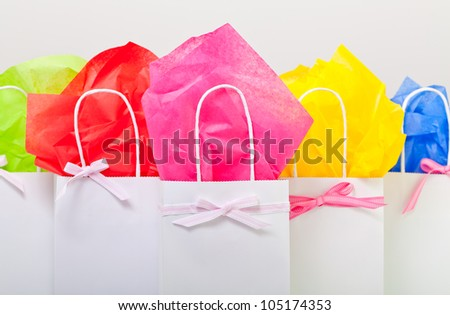 gift bags adorned nicely to represent many things. Hand made with ribbon and tissue paper. - stock photo