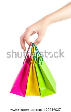 Gift bags in hand - stock photo