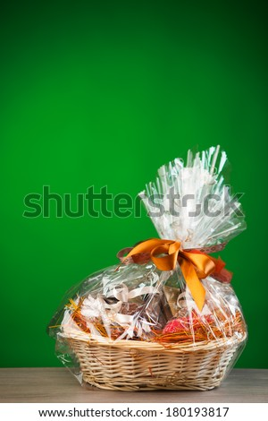 gift basket against green background - stock photo