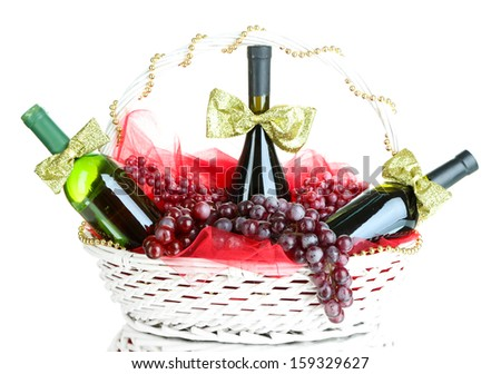 Gift basket with wine isolated on white - stock photo
