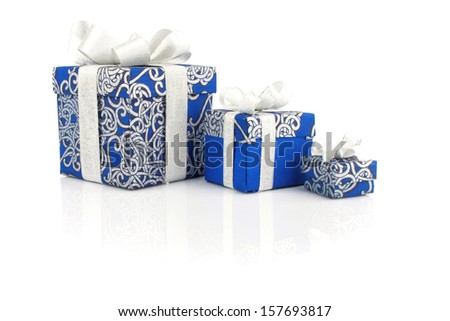 Gift blue boxes with silver ribbon on white - stock photo